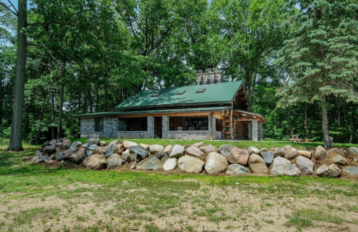 lakefront log home with land