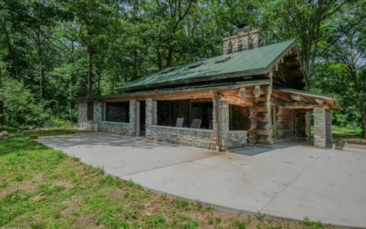 log home on Cedar Lake with 124 acres